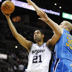 Spurs' Tim Duncan, here shooting over Hornets' Chris Kaman, is a savvy veteran who always causes problems for the Jazz.  during the first half of an NBA basketball game, Friday, April 6, 2012, in San Antonio.