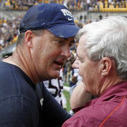 Pittsburgh head coach Paul Chryst, left, meets Virginia Tech head coach Frank Beamer at midfield after their NCAA college football game, Saturday, Sept. 15, 2012, in Pittsburgh. Pittsburgh won 35-17.