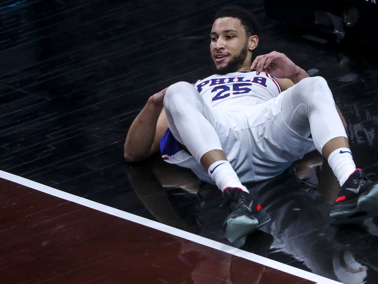 Philadelphia 76ers guard Ben Simmons (25) looks for a foul after being knocked to the court during the Philadelphia 76ers at Utah Jazz NBA basketball game at Vivint Smart Home Arena in Salt Lake City on Monday, Feb. 15, 2021.