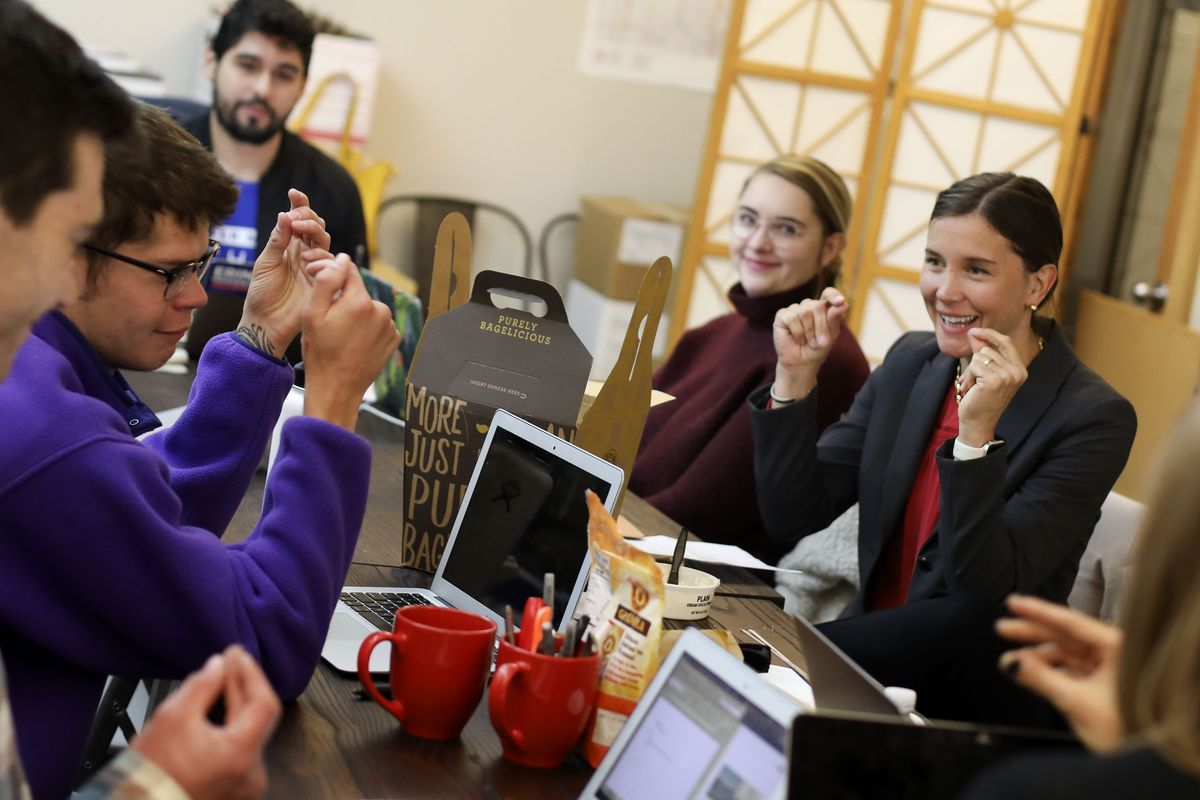 Salt Lake City mayoral candidate Erin Mendenhall laughs with her campaign staff during a meeting at her campaign headquarters in Salt Lake City on Thursday, Oct. 10, 2019.