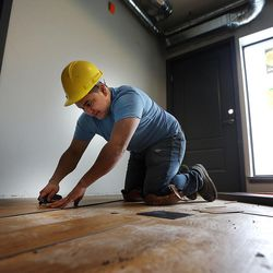 Efren Guzman installs flooring in Salt Lake City on Thursday, Feb. 2, 2017, during construction of the 9th East Lofts at Bennion Plaza. The building will provide 68 affordable apartments.