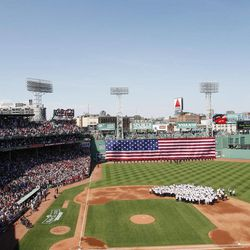An F-16 fighter jet and a WWII era P-51 Mustang fly over the field during ceremonies to celebrate the 100th anniversary of Fenway Park before a baseball game between the New York Yankees and the Boston Red Sox, at Fenway Park in Boston, Friday, April 20, 2012.