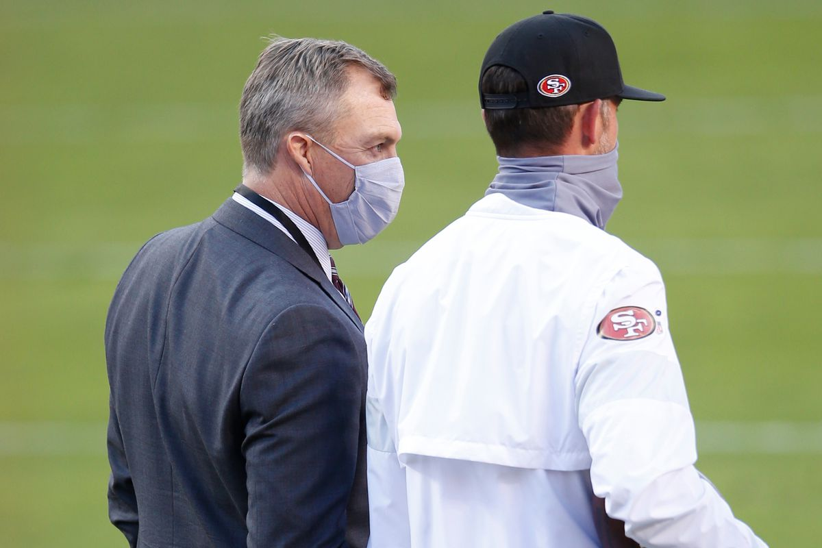 General Manager John Lynch and Head Coach Kyle Shanahan of the San Francisco 49ers on the field prior to the game against the Los Angeles Rams at Levi's Stadium on October 18, 2020 in Santa Clara, California.