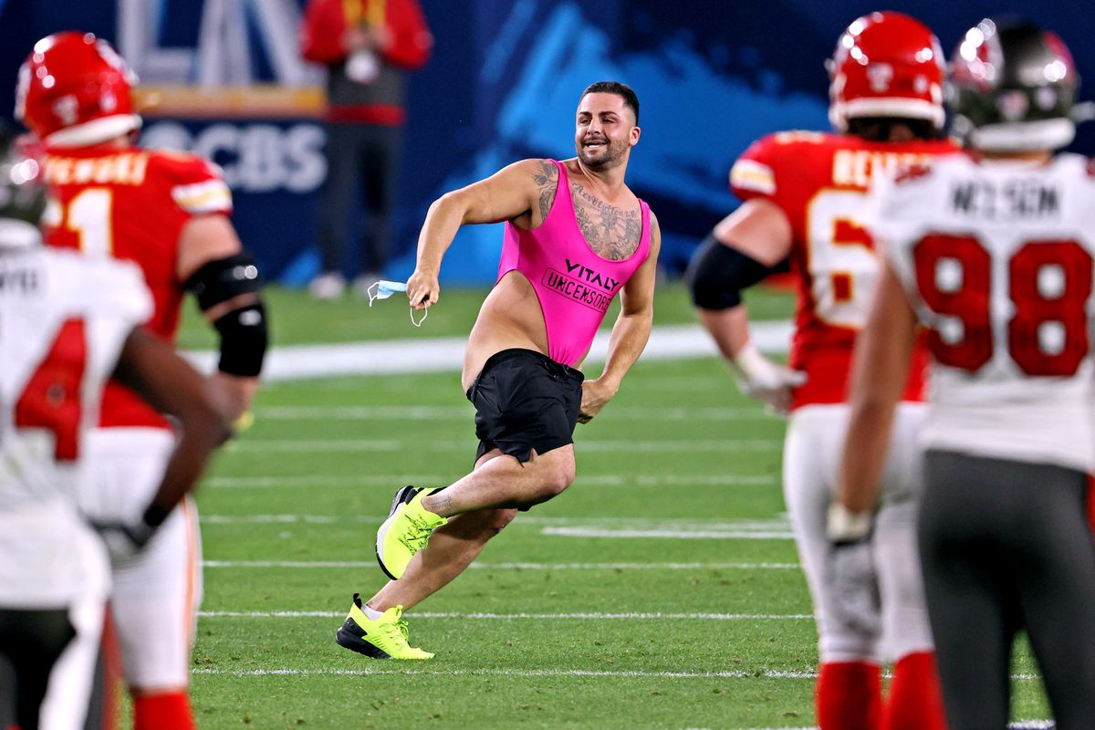 A fans runs onto the field in Super Bowl LV at Raymond James Stadium.