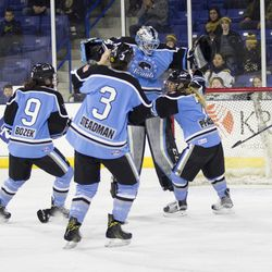 The Buffalo Beauts celebrate winning the Isobel Cup over the Boston Pride at Tsongas Arena in Lowell, MA on March 19.
