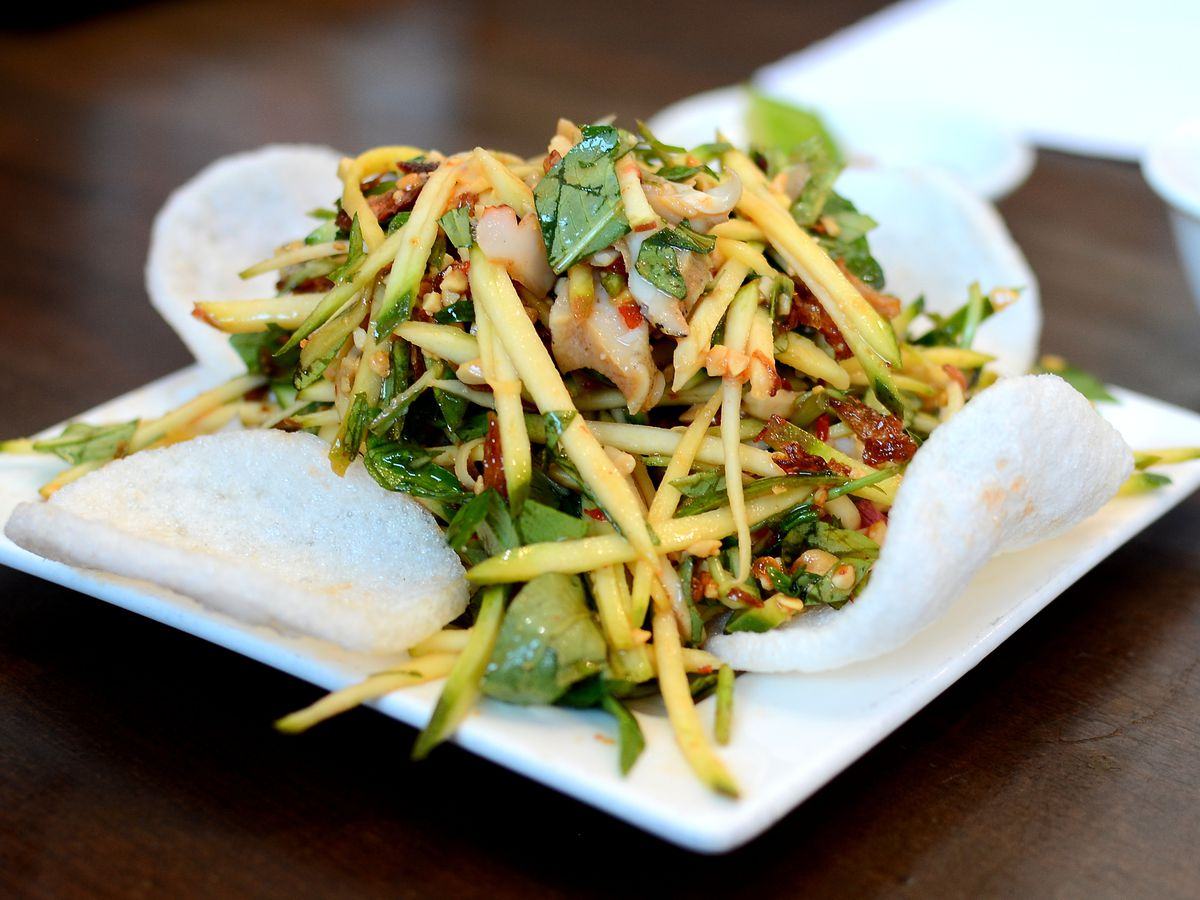 Green mango and snail salad at Oc & Lau in Garden Grove.