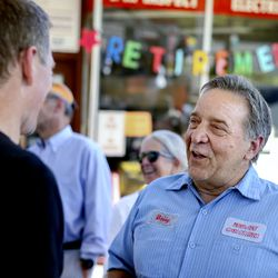 Bobby Rose, owner of 3rd Ave. Car Clinic, speaks with friends at his retirement party in Salt Lake City on Thursday, May 27, 2021. Rose is retiring and closing his auto repair shop after 34-plus years.