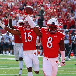 Utah cornerback Clark Phillips III (8) celebrates after returning an interception for a touchdown during the fourth quarter of an NCAA college football game against Washington State at Rice-Eccles Stadium on Saturday, Sept. 25, 2021 in Salt Lake City. Utah won the game 24-13.