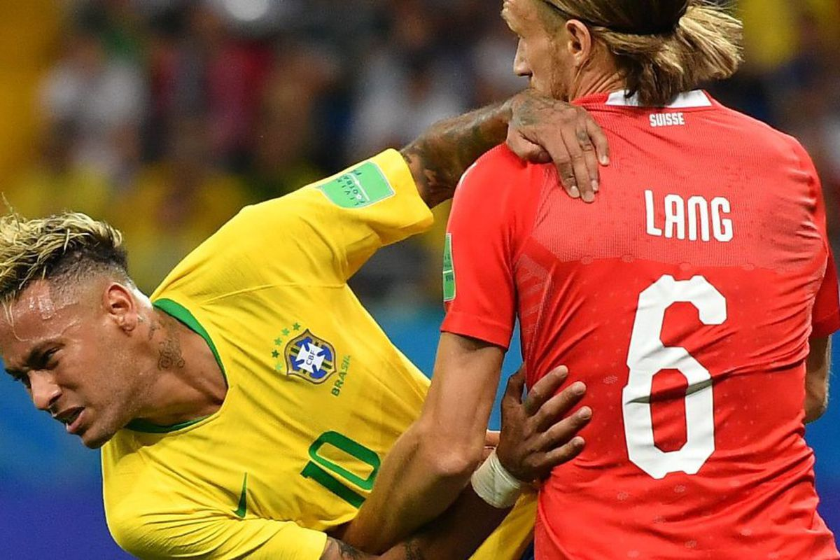 f21e41af6ea TOPSHOT - Switzerland s defender Michael Lang tackles Brazil s forward  Neymar during the Russia 2018 World Cup Group E football match between  Brazil and ...