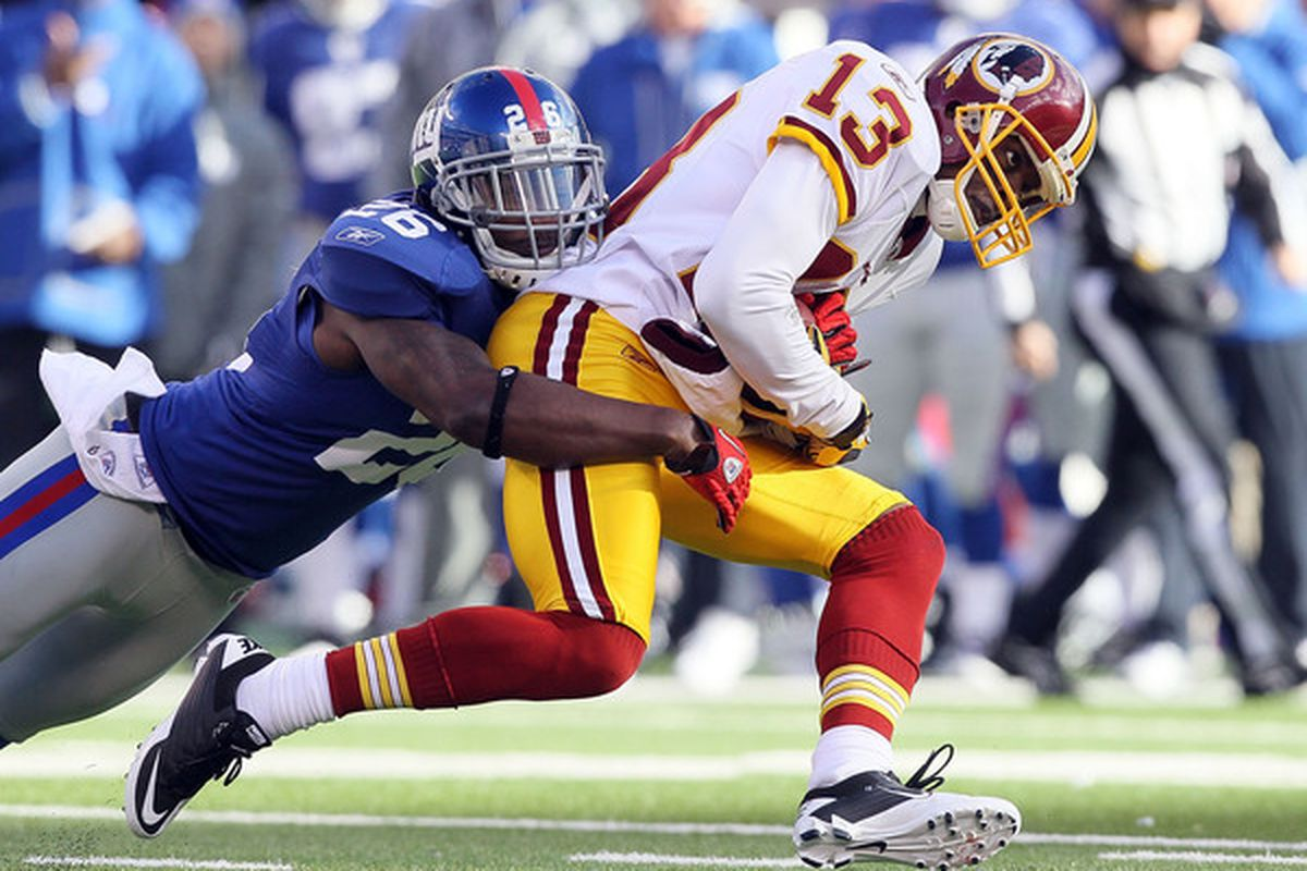 Anthony Armstrong of the Washington Redskins is tackled by Antrel Rolle of the New York Giants on December 5 2010 at the New Meadowlands Stadium in East Rutherford, N.J.  (Photo by Jim McIsaac/Getty Images)