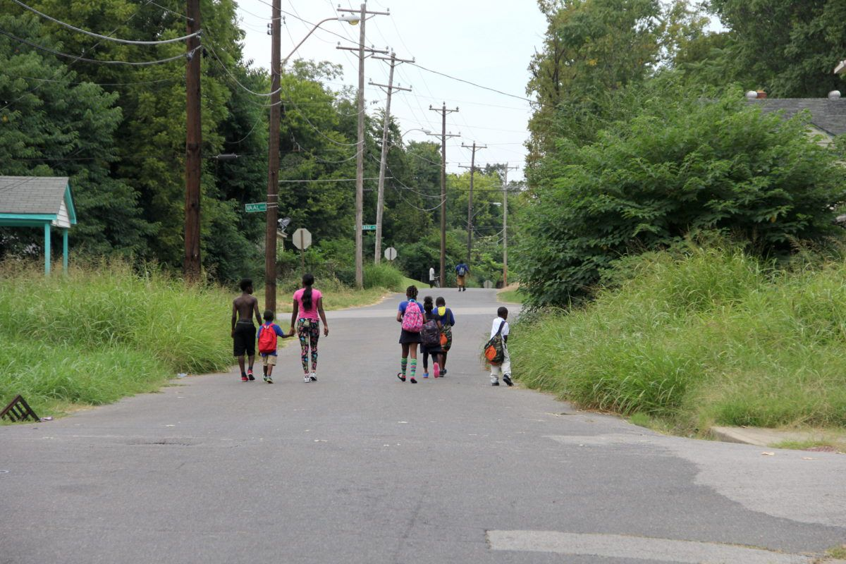 Children at Riverview walk home from school. (2015)