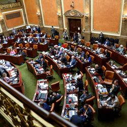 Members of the House of Representatives meet in the House chamber on the final day of the legislative session at the Capitol in Salt Lake City on Thursday, March 12, 2020.
