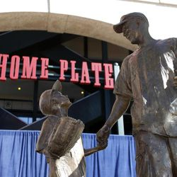 The Fan Statue is displayed after being unveiled during a dedication ceremony on Thursday, April 5, 2012, in Arlington, Texas. The statue is of Ranger's fan Shannon Stone, who died after falling out of the stands trying to catch a ball in 2011, and his son Cooper.