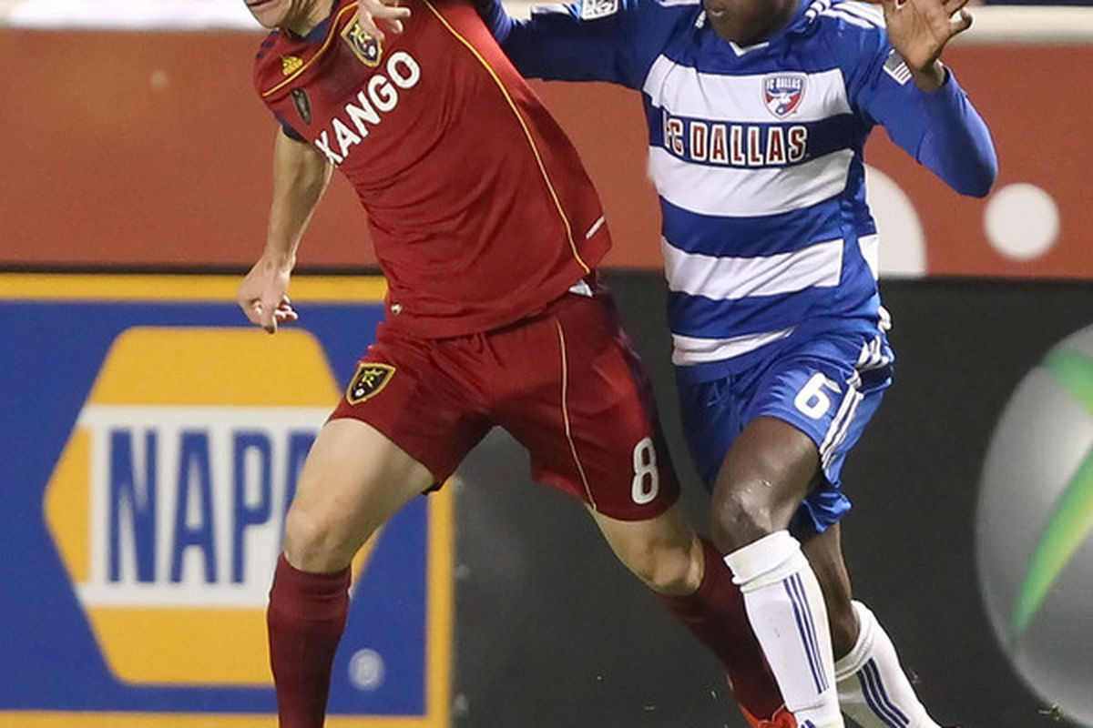 SANDY UT - NOVEMBER 6: Will Johnson #8 of Real Salt Lake and Jackson Goncalves #6 of FC Dallas fight for the ball during the first half of an MLS playoff  game November 6 2010 at Rio Tinto Stadium in Sandy Utah. (Photo by George Frey/Getty Images)