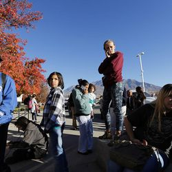 Students and parents gather outside Mountain View High School in Orem on Tuesday, Nov. 15, 2016, after five students were stabbed in an apparent attack by a 16-year-old boy.