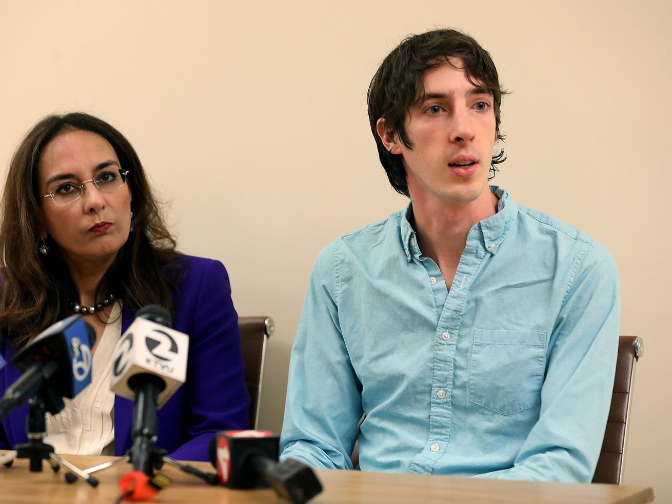 James Damore sits with his attorney at a press conference.