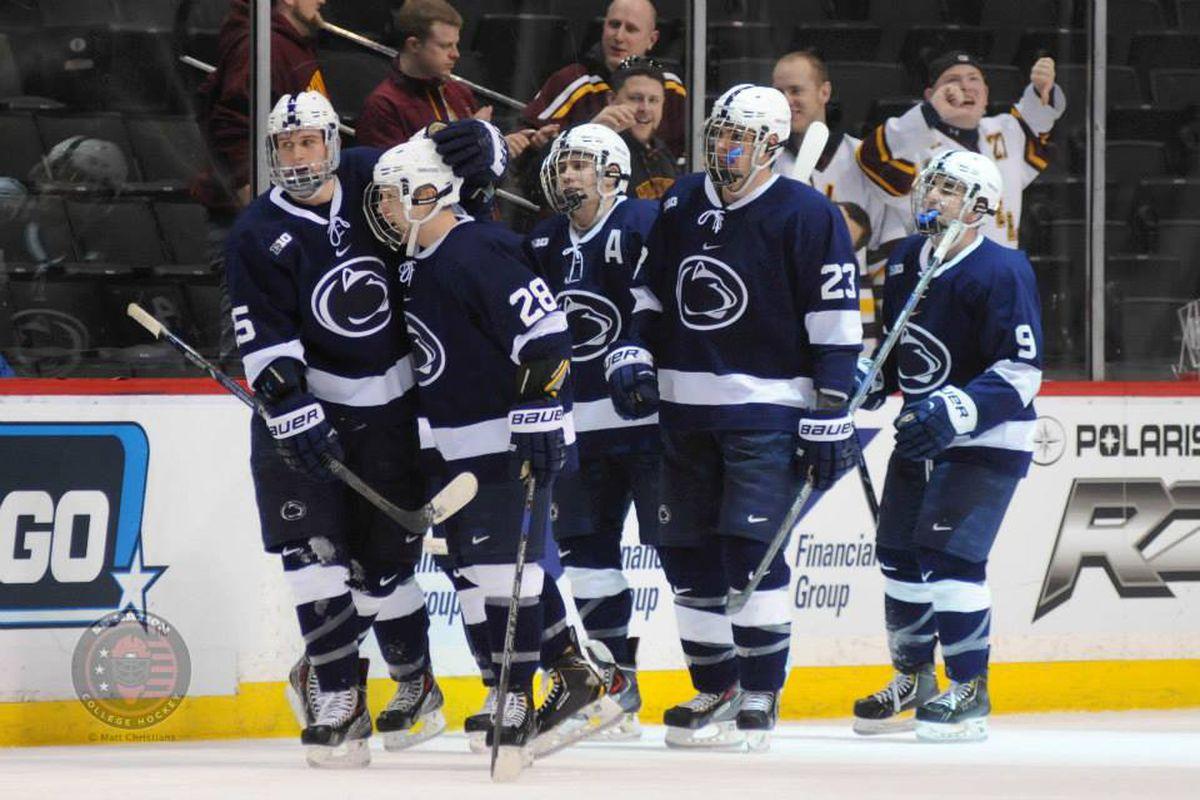 Penn State players celebrate a goal.