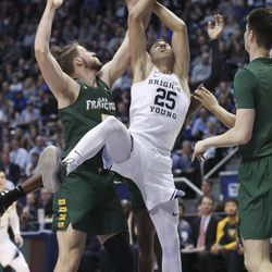 Brigham Young Cougars forward Gavin Baxter (25) competes for the ball with San Francisco Dons center Jimbo Lull (5) in Provo on Saturday, Feb. 8, 2020.