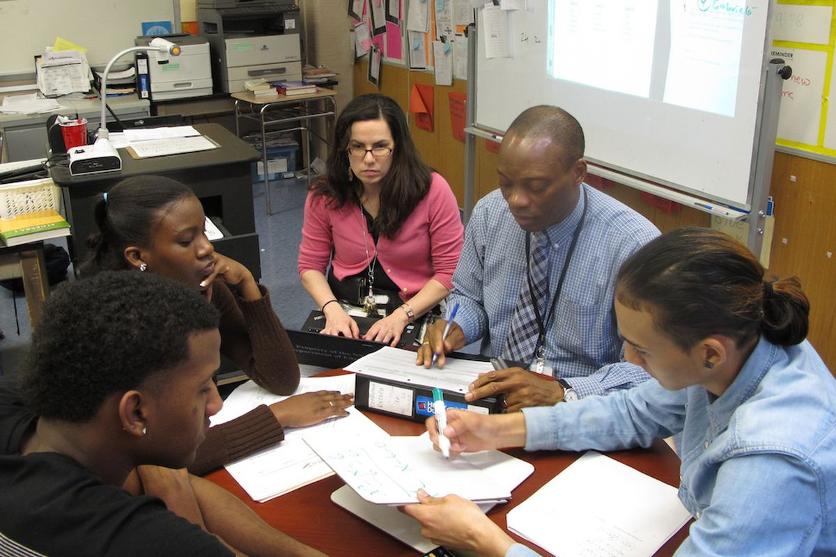 A New York City principal takes notes on her computer during classroom observation for new teacher evaluations.