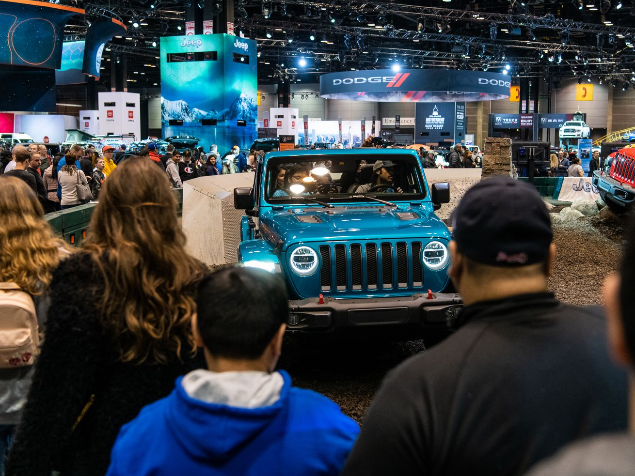 A crowd waits in line to test drive Jeep vehicles at the Jeep test driving course Saturday at the 2020 Chicago Auto Show at McCormick Place.