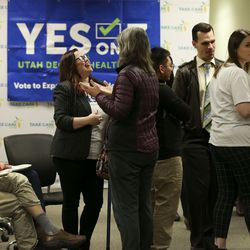 People attend a Medicaid expansion celebration and enrollment event at the Utah Health Policy Project in West Valley City on Wednesday, Jan. 15, 2020.