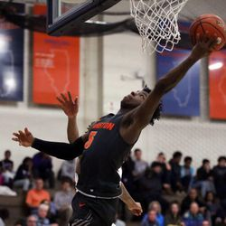 Evanston's Lance Jones (5) puts up a layup against Oak Park in their 79-69 win in Oak Park,  Saturday, February 2, 2019. | Kevin Tanaka/For the Sun Times