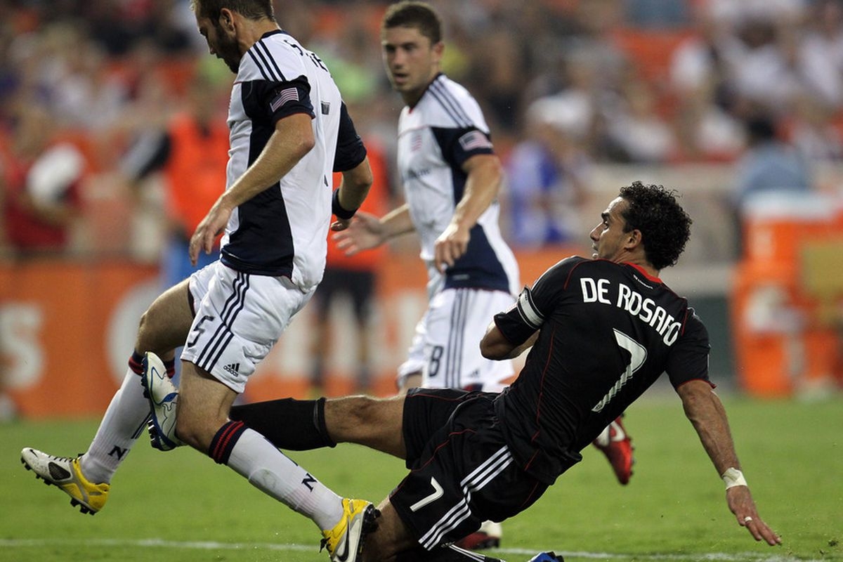 WASHINGTON, DC - JULY 20: Dwayne De Rosario #7 of D.C. United puts a shot on goal against A.J. Soares #5 of the New England Revolution at RFK Stadium on July 20, 2011 in Washington, DC. (Photo by Ned Dishman/Getty Images)