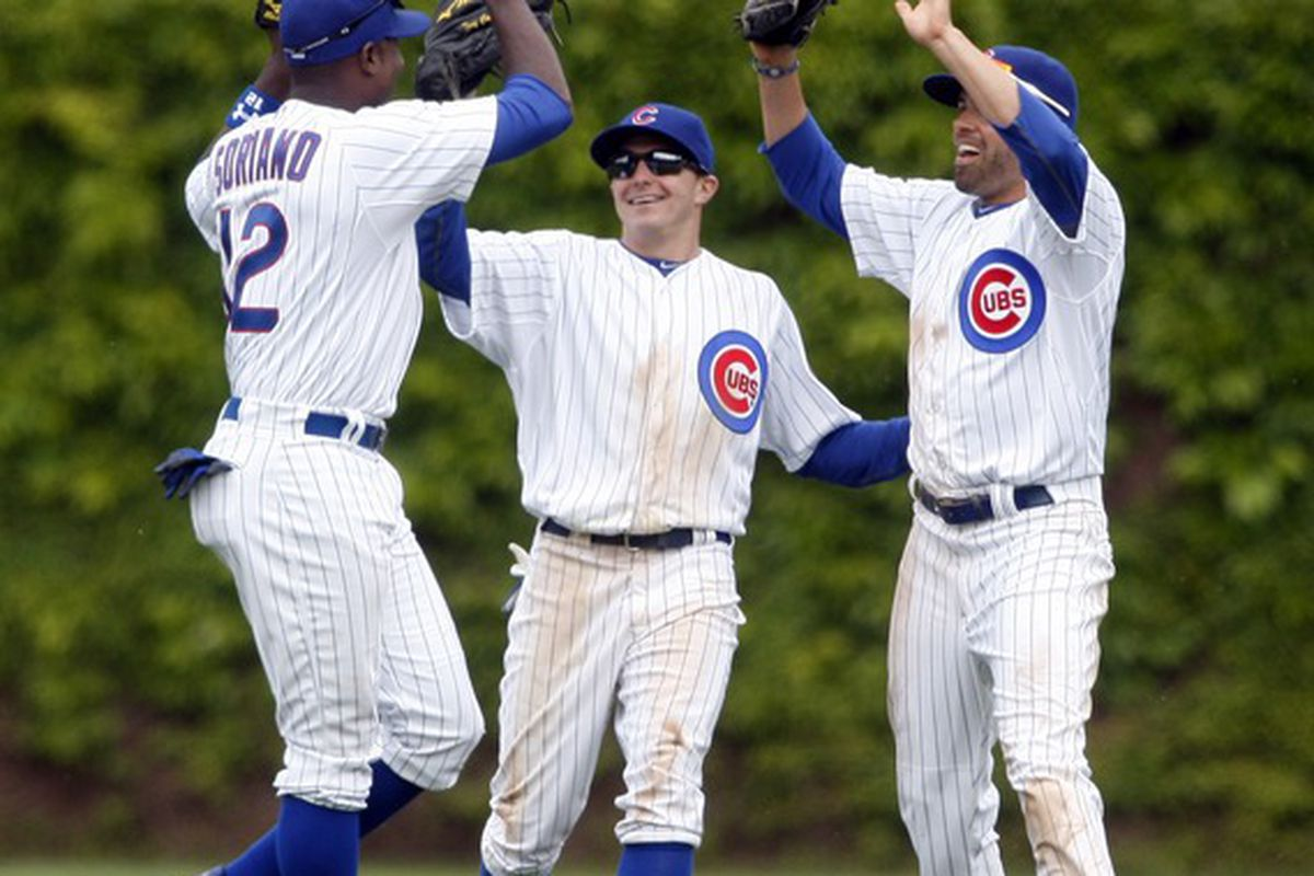 Chicago, IL, USA; Chicago Cubs outfielders Alfonso Soriano, Tony Campana and David DeJesus celebrate after defeating the Los Angeles Dodgers 5-4 at Wrigley Field.  Credit: Jerry Lai-US PRESSWIRE