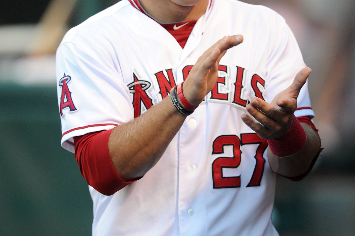 Jul 24, 2012; Anaheim, CA, USA; Los Angeles Angels center fielder Mike Trout (27) talks in the dug out prior to the game against the Kansas City Royals at Angel Stadium of Anaheim. Mandatory Credit: Kelvin Kuo-US PRESSWIRE