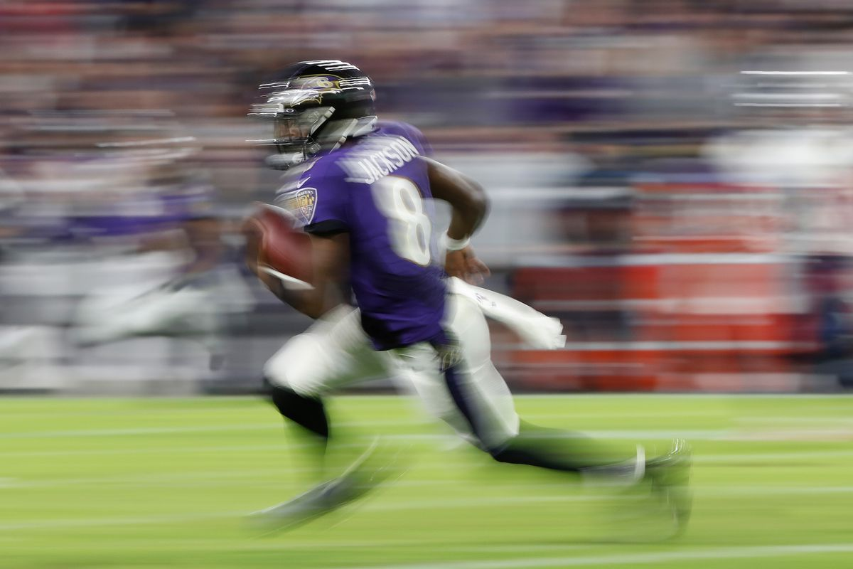 Baltimore Ravens quarterback Lamar Jackson runs with the ball against the Tennessee Titans in a AFC Divisional Round playoff football game at M&T Bank Stadium.