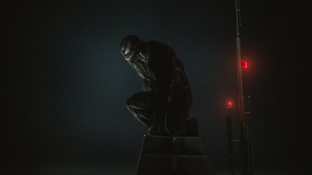Venom perched on a rooftop in Venom: Let There Be Carnage