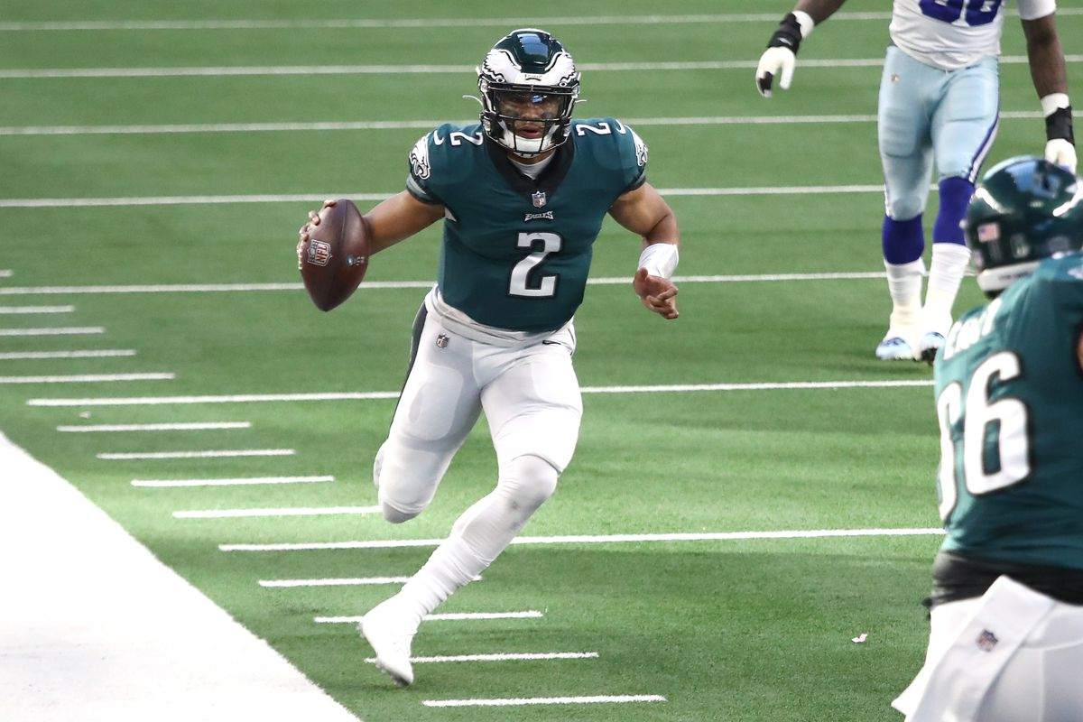 Jalen Hurts of the Philadelphia Eagles runs toward the end zone in the first half against the Dallas Cowboys at AT&T Stadium on December 27, 2020 in Arlington, Texas.