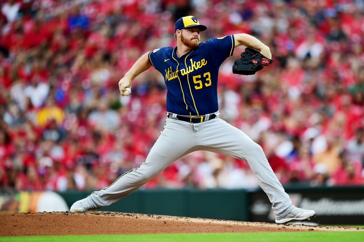Brandon Woodruff #53 of the Milwaukee Brewers pitches during a game between the Cincinnati Reds and Milwaukee Brewers at Great American Ball Park on July 17, 2021 in Cincinnati, Ohio.