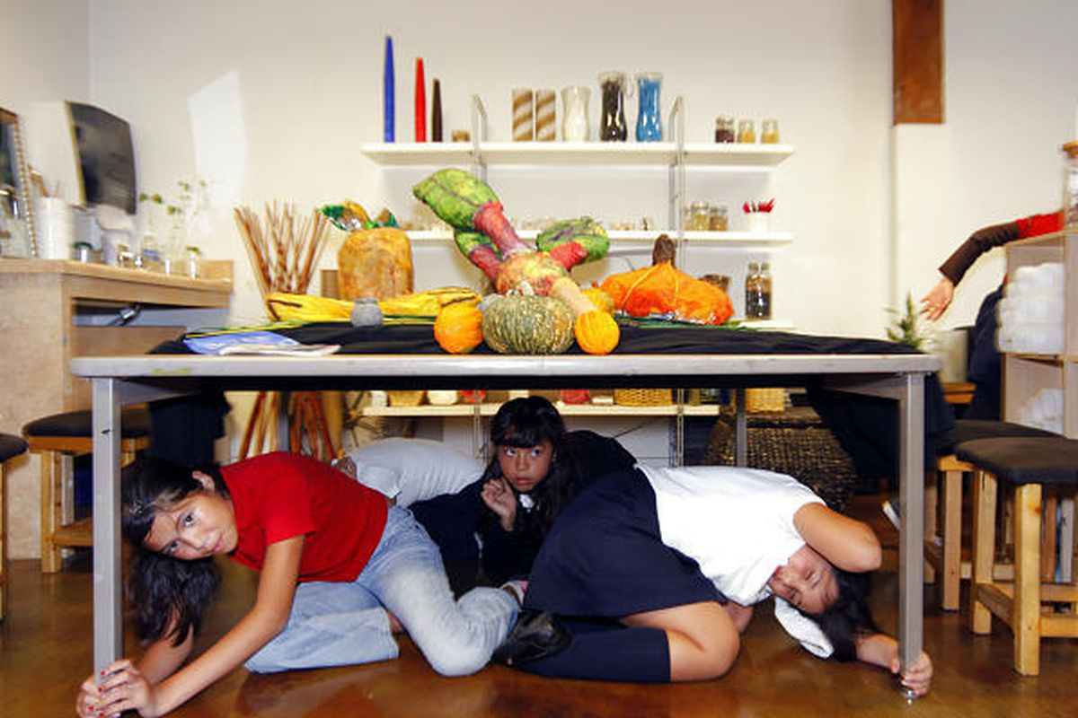 Children participate in the Great California ShakeOut earthquake drill in Los Angeles.