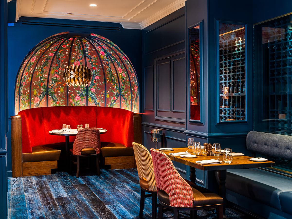 A half-circle booth with dramatic red seats has a domed ceiling that looks like a fabergé egg.