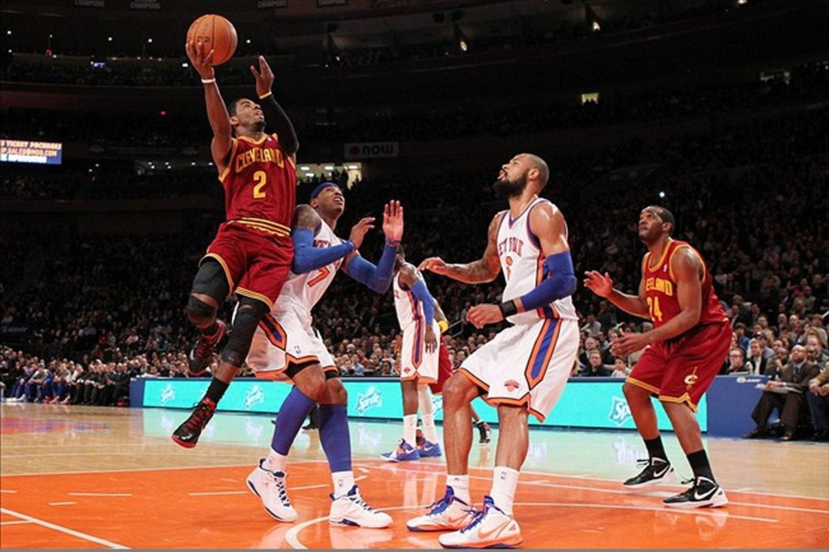 Feb 29, 2012; New York, NY, USA;  Cleveland Cavaliers point guard Kyrie Irving (2) shoots over New York Knicks small forward Carmelo Anthony (7) during the first quarter at Madison Square Garden.  Mandatory Credit: Anthony Gruppuso-US PRESSWIRE