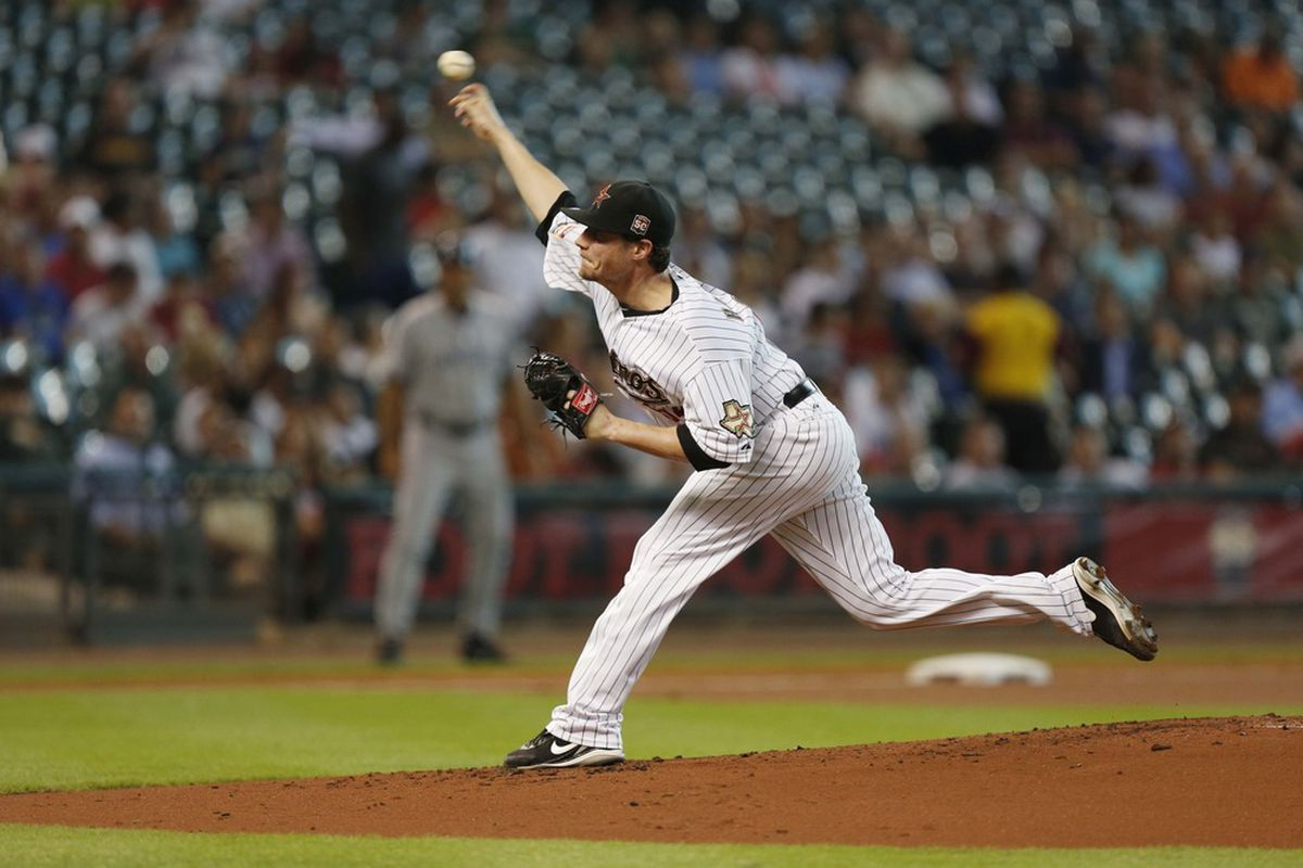 June 27, 2012; Houston, TX, USA; Houston Astros starting pitcher Lucas Harrell (64) pitches against the San Diego Padres during the second inning at Minute Maid Park. Mandatory Credit: Thomas Campbell-US PRESSWIRE