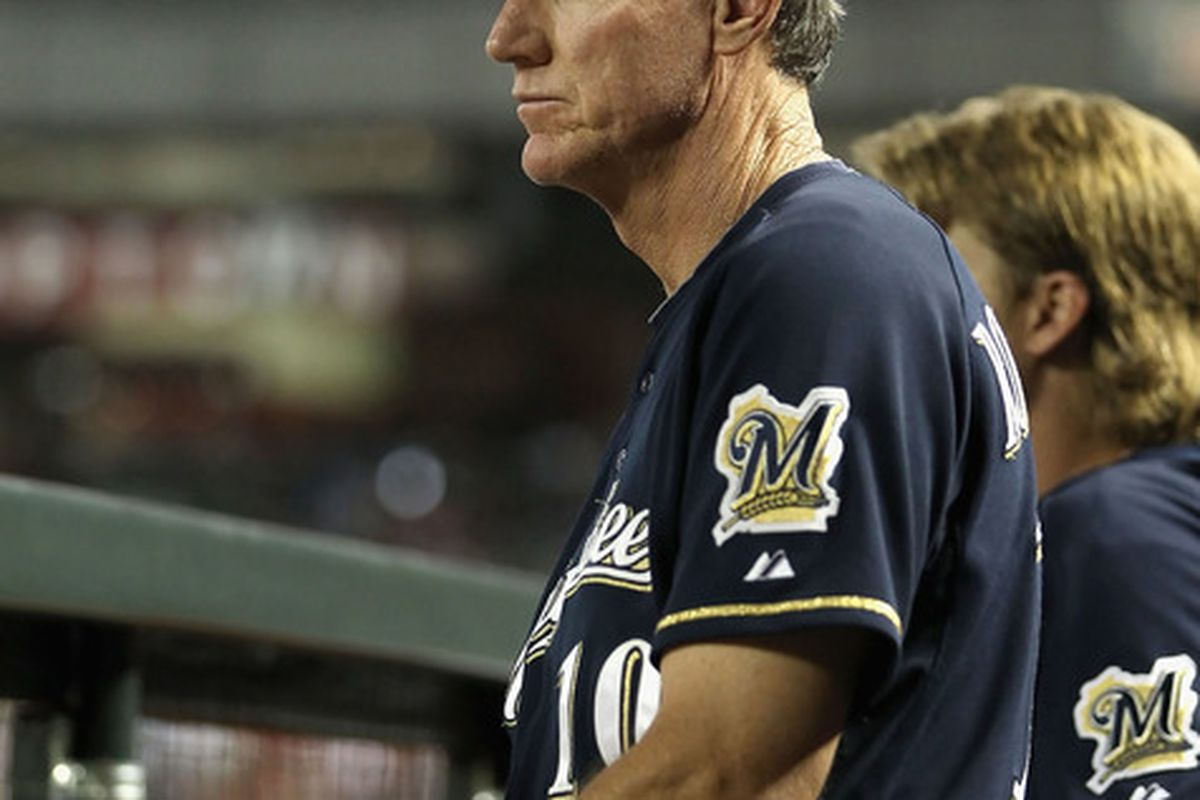 Ron Roenicke watches from the dugout as the Brewers got shut out again.