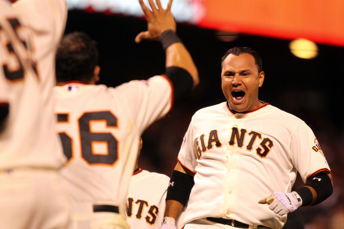 San Francisco Giants' Guillermo Quiroz (12) celebrates his solo walk-off home run (Anda Chu/Bay Area News Grou
