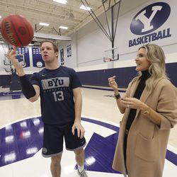 Lee Anne Pope, wife of BYU basketball coach Mark Pope, right, watches BYU player Taylor Maughan spin a ball at the university in Provo on Wednesday, Feb. 26, 2020.
