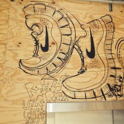 Stopped by the <b>Nike</b> store. I love the mural in their running store, which was based on sketches by one of their footwear designers.