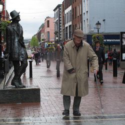 A man walks past the statue of author James Joyce on the main shopping boulevard of Dublin on Thursday, April 26, 2012. Ireland's economy has suffered four straight years of falling property prices and consumer spending in the face of rising taxes, unemployment and emigration. The European Union and International Monetary Fund said Thursday that Ireland's government must keep cutting its spending overall but do more to create jobs and stimulate the economy.