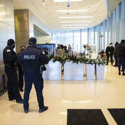 Chicago police officers wait in the hallway at the University of Chicago Medical Center in Hyde Park to hear news about a fellow officer who was shot while in his personal vehicle, Monday afternoon, March 15, 2021.
