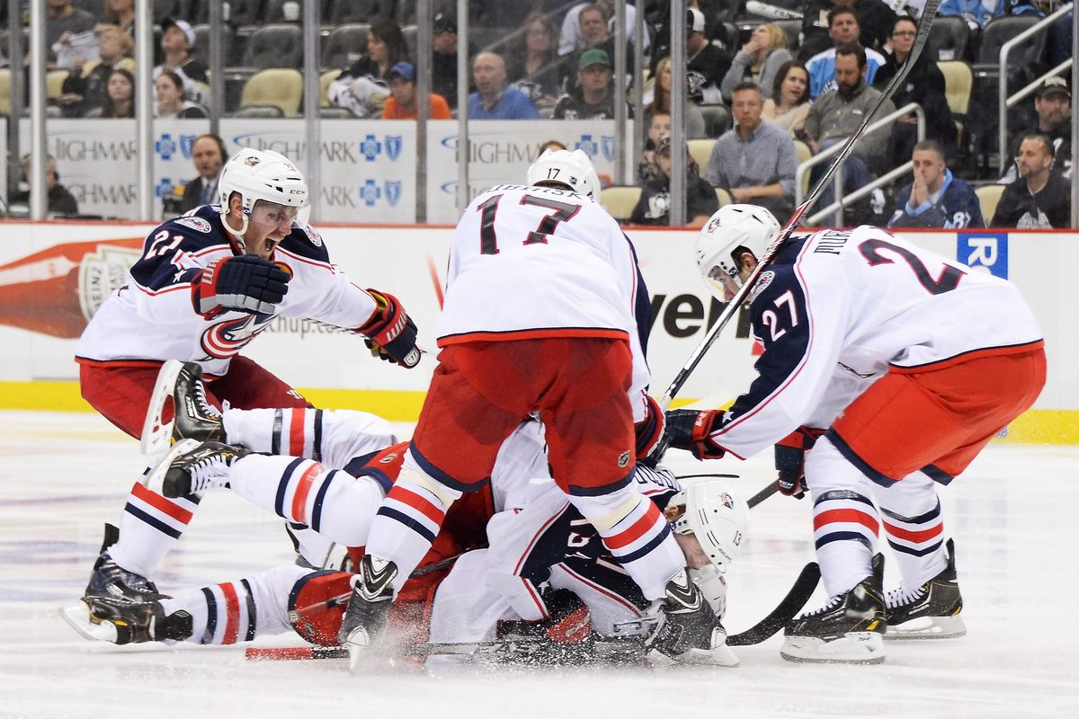 The Blue Jackets mob Matt Calvert after his overtime winner in Game 2 in Pittsburgh.