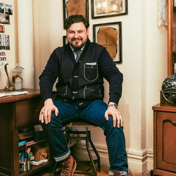 Design Director Krys Manieczki is wearing a J. Crew jacket, Tellason jeans, a vintage shirt, custom Whites boots, a vintage Rolex, and Dad's class ring.