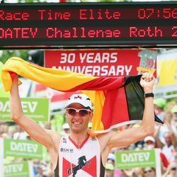 Timo Bracht of Germany celebrates winning the Challenge Roth on July 20, 2014 in Roth, Germany. (Photo by Alex Grimm/Getty Images)