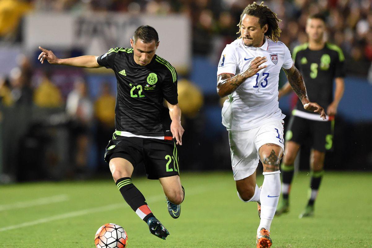 Paul Aguilar attempts to dribble past USA midfielder Jermaine Jones