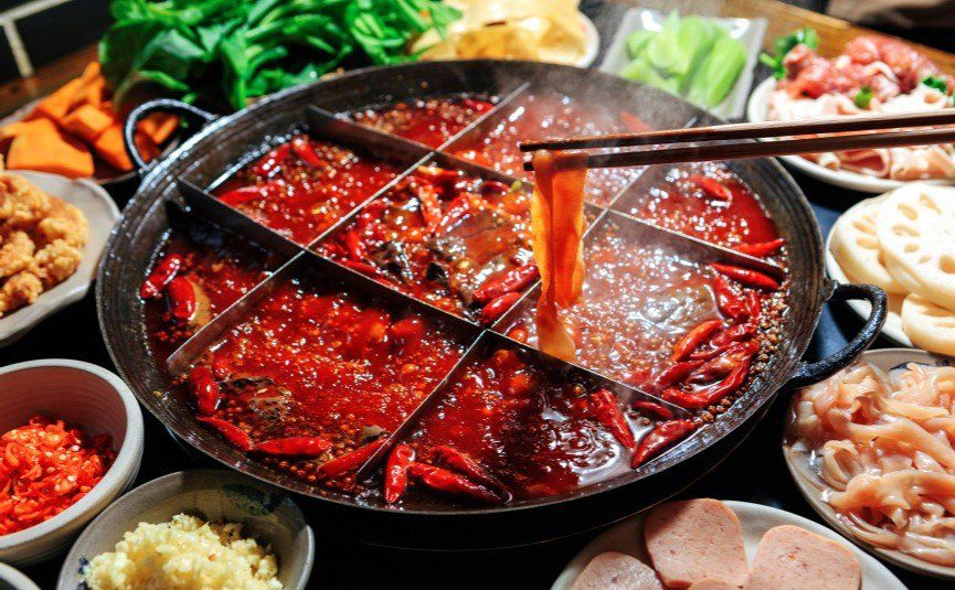Spicy kung fu hot pot served by robot waiters