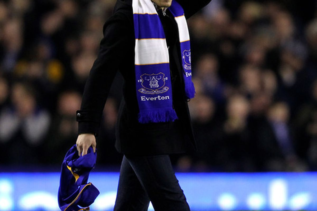 """""""Hopefully the first of many celebratory waves"""" - new Everton signing Nikica Jelavic salutes fans at half time during the 1-0 win against Manchester City at Goodison Park. (Photo by Alex Livesey/Getty Images)"""
