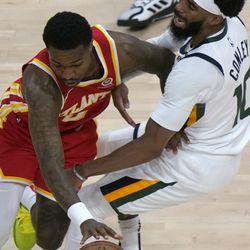 Atlanta Hawks guard Brandon Goodwin (0) is fouled by Utah Jazz guard Mike Conley (10) in the first half of an NBA basketball game Thursday, Feb. 4, 2021, in Atlanta.